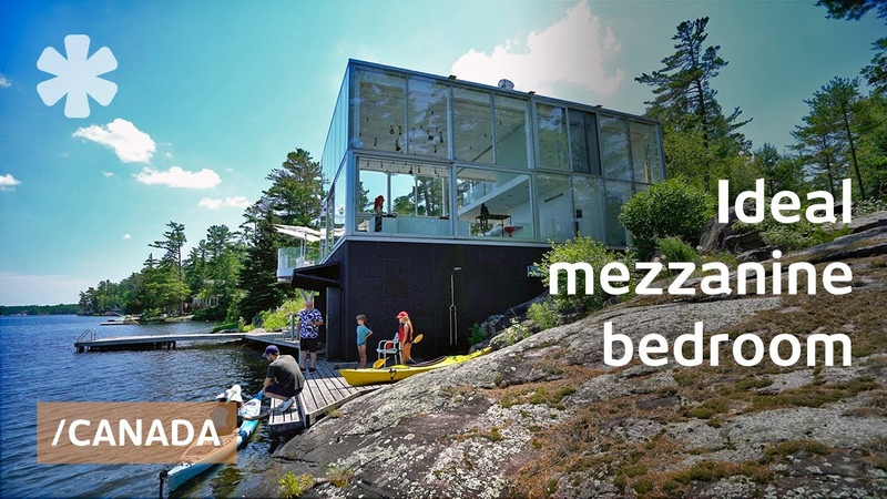 Photographer's open floor glass home perches over Canadian lake