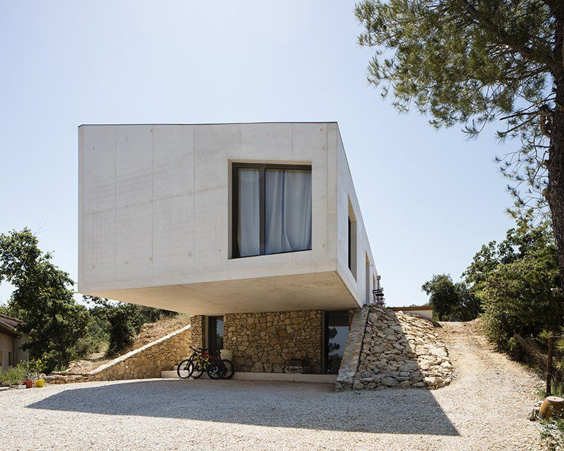 Pan architecture adds a geometric family residence to rolling French fields