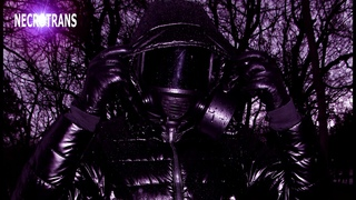 BLACK GLOSSY SKI OVERALL AND MODERN CZECH PANORAMIC GAS MASK. WALK IN A BLACK SUIT.