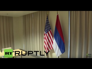 Switzerland: 'The white should be on top?' US hang Russian flag upside down at Lavrov-Kerry meeting