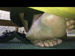 Candid college girl smelly feet out of flats under desk. closeup!
