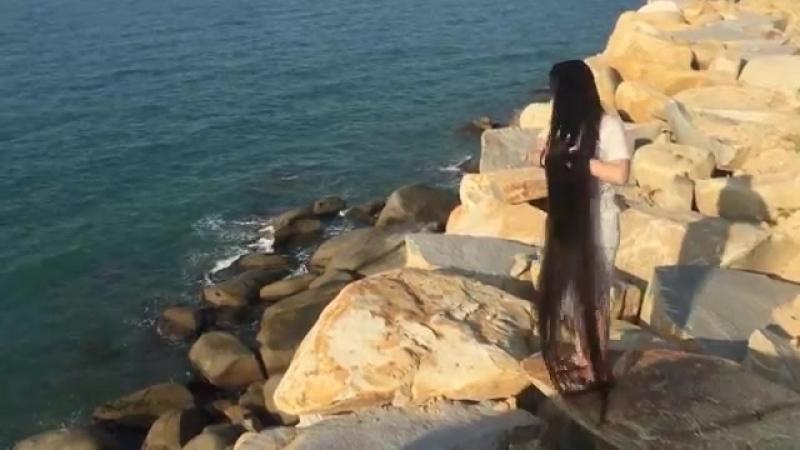 Super long hair Selia Cullen at the beach in Viet