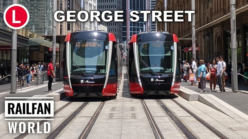 New Sydney Light Rail Trams in George Street with third rail APS Circular Quay to Haymarket