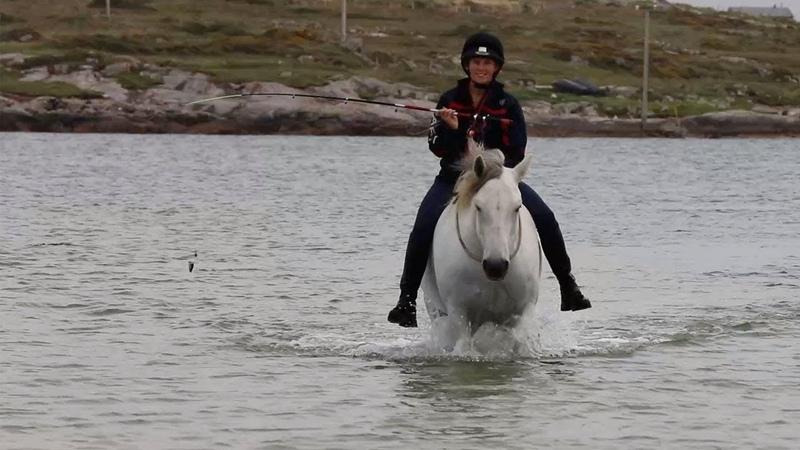 Woman Goes Fishing On Horseback